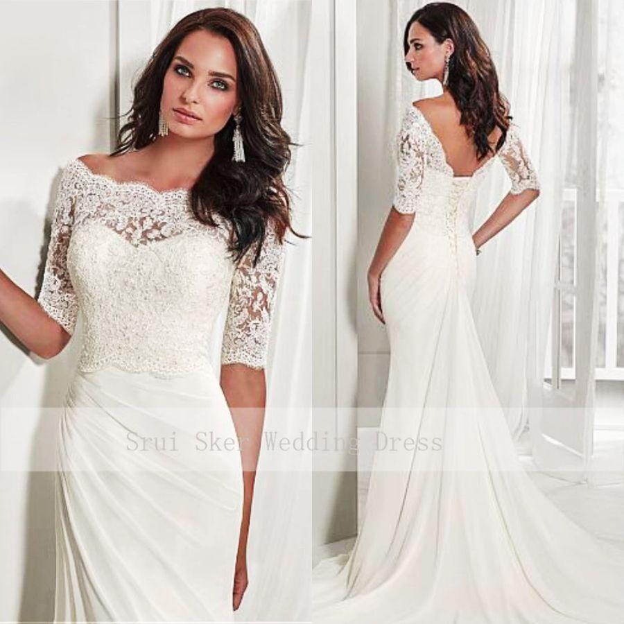 Elegante vestido de novia largo con media manga de enca